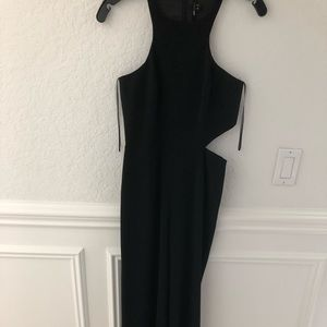 Jumpsuit with sexy side cutout.